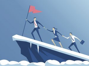 business people climb to the top of the mountain, leader helps the team to climb the cliff and reach the goal, business concept of leadership and teamwork