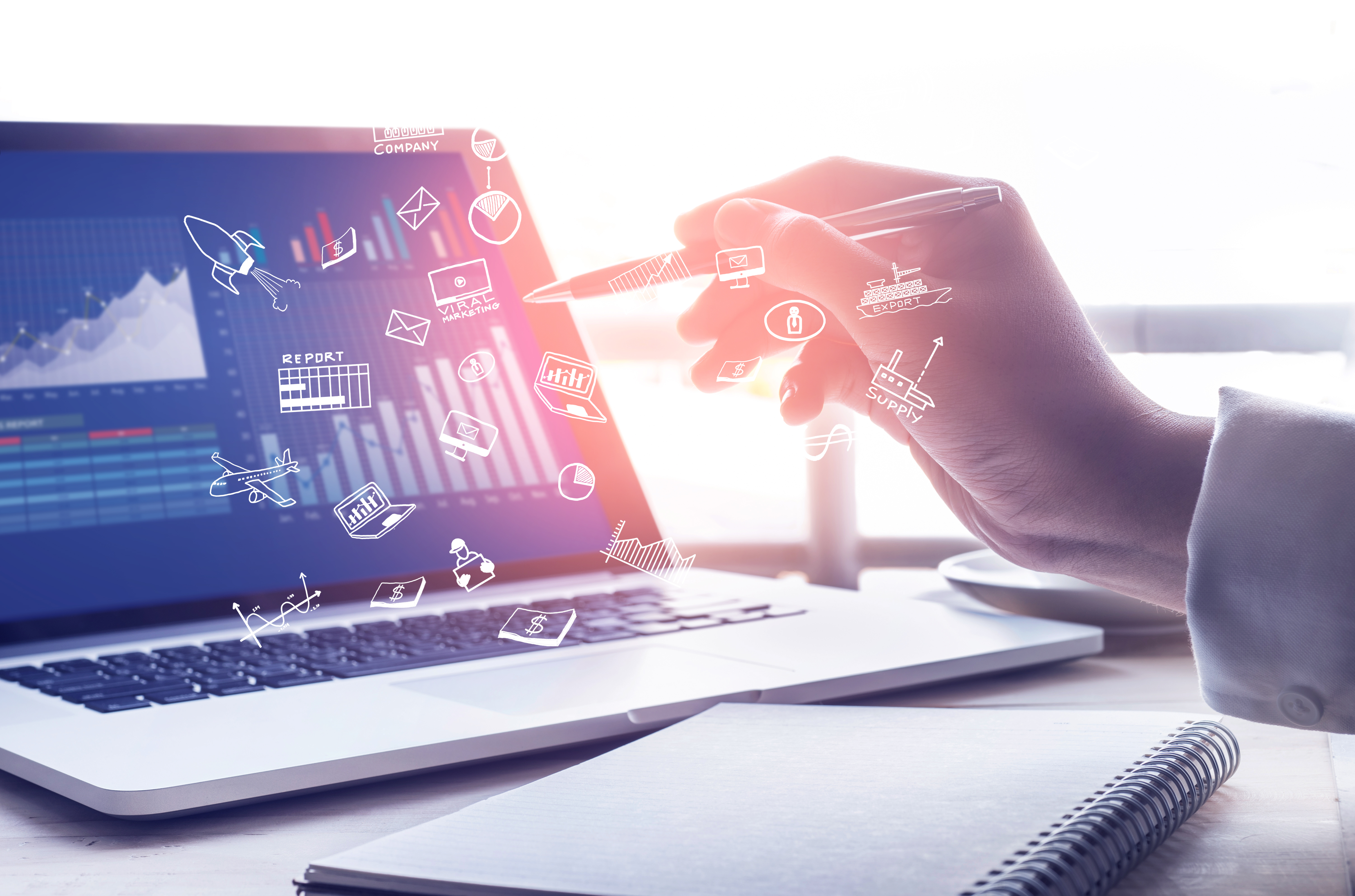 Businessman using modern laptop with graph.Business startup.Analyze strategy conceptsBusinessman using modern laptop with graph.Business startup.Analyze strategy conceptsStrategy text with business icon on modern laptop screen with graph chart background.marketing success and goals concept ideas